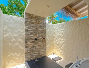 You & Me Beach Suite Pool Bathroom with Somos Lifestyle Management