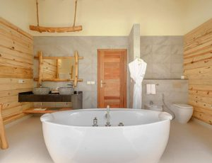 You & Me Beach Suite Pool Hotel Bathroom with Somos Lifestyle Management
